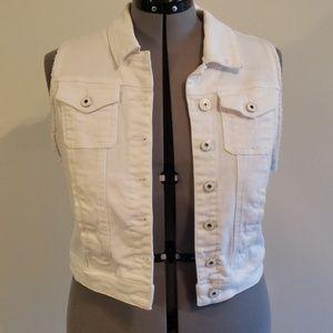 White slightly distressed sleeveless jean jacket